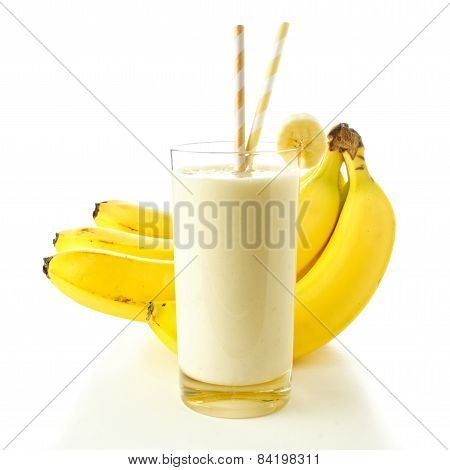 Smoothie with bananas over white