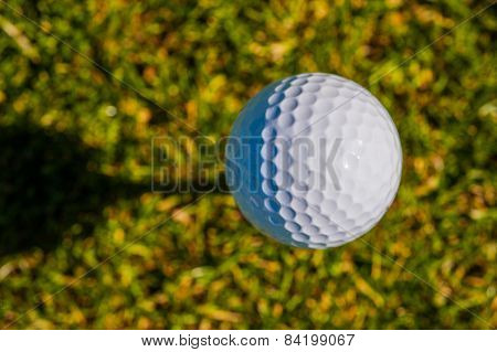 Golf Ball Sits On A Wooden Tee