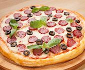 picture of hot fresh pizza  - Fresh flavorful pepperoni pizza on a wood - JPG