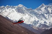 image of rescue helicopter  - Lifeguard helicopter in Himalaya mountains in Nepal - JPG