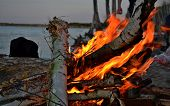 stock photo of bonfire  - bonfire night by the lake boil tea in a metal mug - JPG