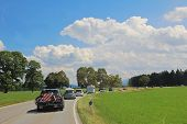 stock photo of bavarian alps  - traffic jam on the road to the alps bavarian landscape - JPG