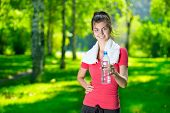 pic of cold drink  - Young woman drinking cold mineral water after sport fitness exercise at green summer park - JPG
