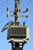 foto of transformer  - view of modern voltage transformer on a pole
