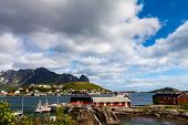 pic of lofoten  - Scenic town of Reine by the fjord on Lofoten islands in Norway on sunny summer day - JPG