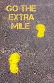 stock photo of mile  - Yellow footsteps on sidewalk - JPG