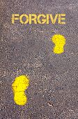 foto of forgiveness  - Yellow footsteps on sidewalk towards Forgive message - JPG
