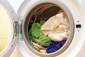 picture of washing-machine  - Clothes inside of washing machine taken closeup - JPG