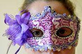 picture of purim  - Woman wearing vintage venetian mask on Purim Jewish holiday - JPG