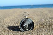 foto of orientation  - Orientation Concept One Compass on the Beach near the Atlantic Ocean - JPG