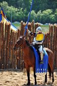 pic of jousting  - armored medieval knight on horseback at jousting competition - JPG