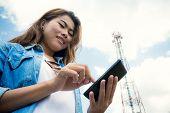 stock photo of freedom tower  - Beauty Women Use Smart Phone And Satellite Telecommunication Tower Background - JPG