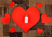 picture of usb flash drive  - USB Flash Drive with Heart Shape on the Fabric Background - JPG