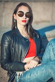 picture of birthmark  - Young fashion hipster beautiful girl in leather jacket and sunglasses outdoor in the city