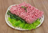 stock photo of veal meat  - Raw minced meat with rosemary and thyme ready for cooking - JPG