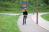 image of dreadlocks  - Young blonde girl with dreadlocks skating in park - JPG