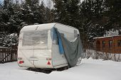 picture of camper  - camper covered by  snow in winter on a cloudy day - JPG