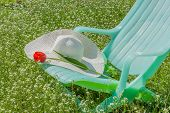 image of panama hat  - Deckchair tulip and hat in the spring garden against the backdrop of cherry blossoms - JPG