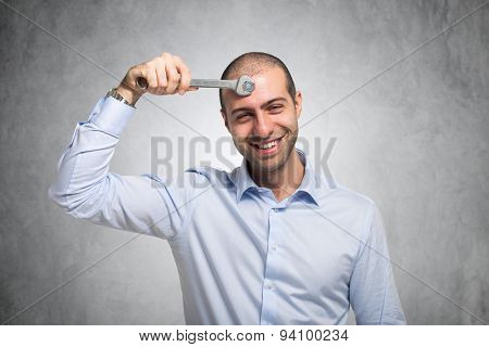 Smiling man using a wrench to adjust his mind