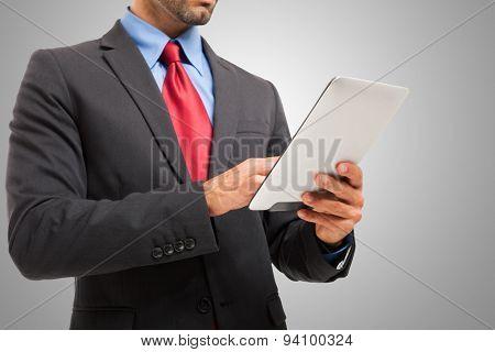 Detail of an entrepreneur using his digital tablet
