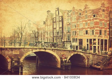 Retro image of Prinsengracht Canal, Amsterdam, The Netherlands.  Added paper texture. Toned image