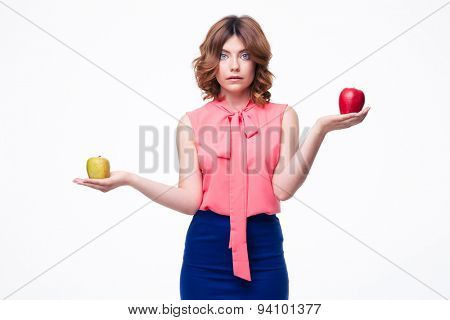 Casual woman holding apples on palms isolated on a white background. Looking at camera