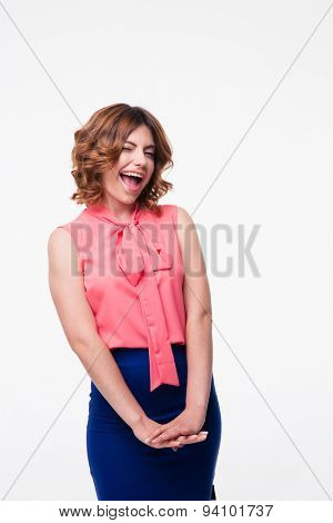 Happy casual woman winking at camera isolated on a white background