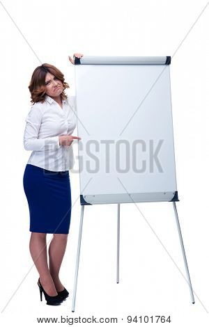 Full length portrait of a sad businesswoman pointing finger on flipchart isolated on a white background. Looking at camera