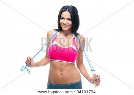 Happy fitness woman holding skipping rope isolated on a white background