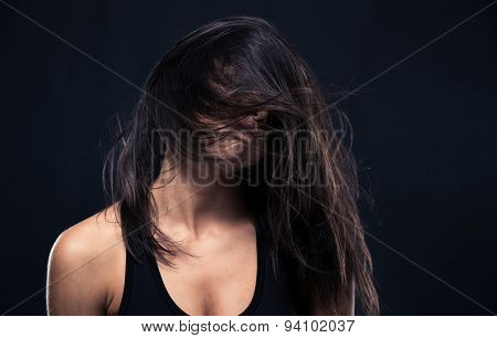 Portrait of exhausted woman over black background