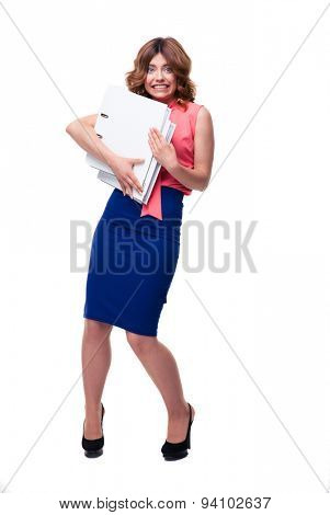 Full length portrait of a frightened businesswoman standing with folders isolated on a white background