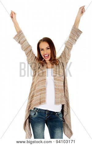 Happy successful woman in winner gesture.