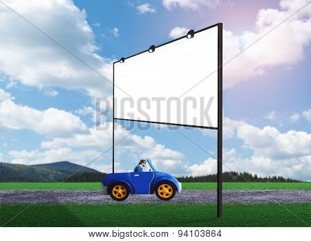 Businessman driving a toy car
