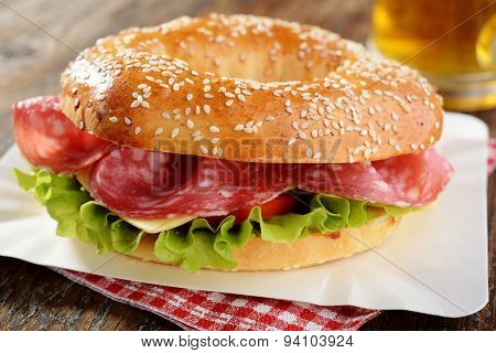 Bagel sandwich with sausage, cheese, and lettuce