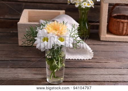 Beautiful flowers in vase on table close up