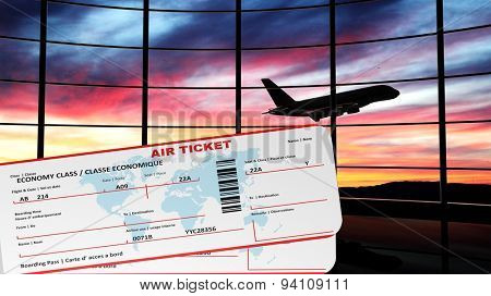 Air tickets with sunset and airplane silhouette as background
