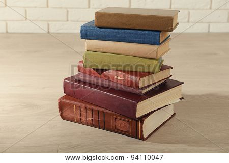 Heap of old books on floor close up