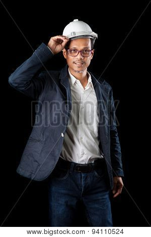 Portrait Of 45S Years Old Asian Engineering  Man With Studio Light On Black Background