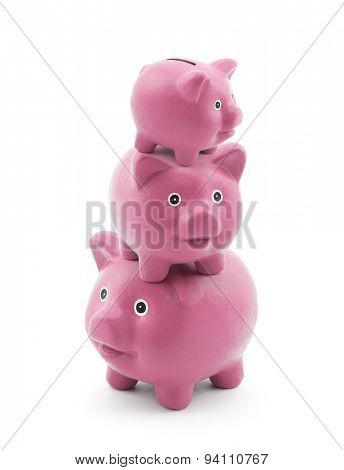 Stack of pink piggy banks