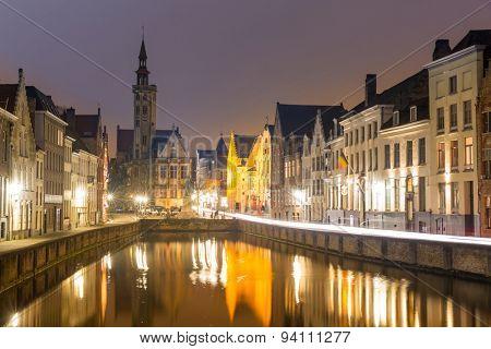 Historic medieval buildings in Bruges, Belgium at night.