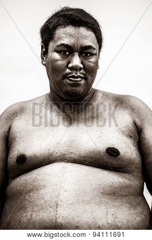 Fat Naked Upper Body And Belly Stomach Of An African Tribal Man Showing Proud Expression On His Face