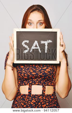 University College Student Holding A Chalkboard Saying Sat