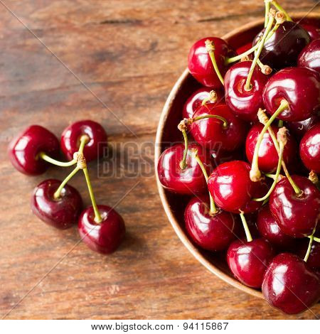 Ripe Cherries In A Bowl Made Of Copper