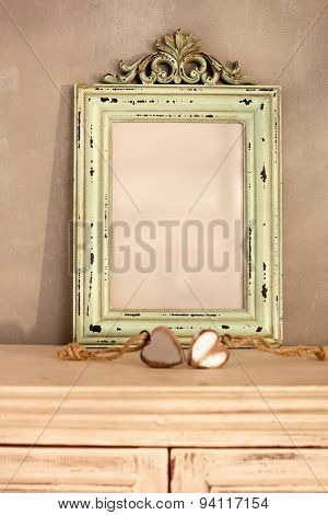 Vintage style home interior with worn frame and heart ornaments.