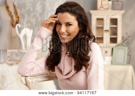 Portrait of beautiful young shy woman smiling happy.