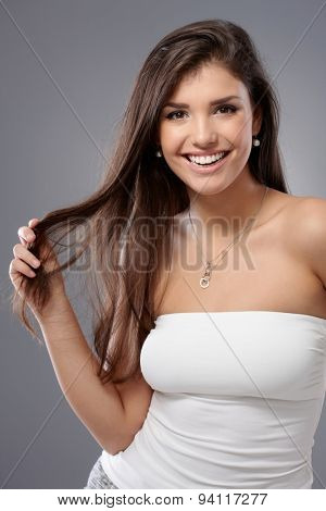 Portrait of happy young sexy woman smiling, looking at camera.