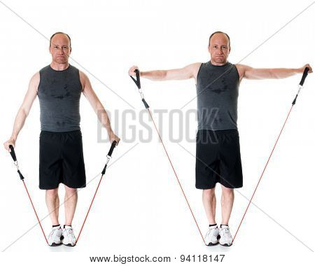 Lateral raise exercise with resistance band. Studio shot over white.