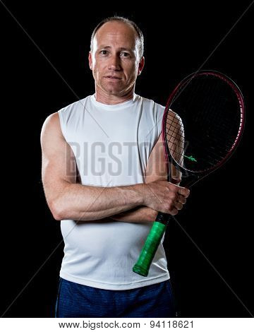 Adult male tennis player. Studio shot over black.