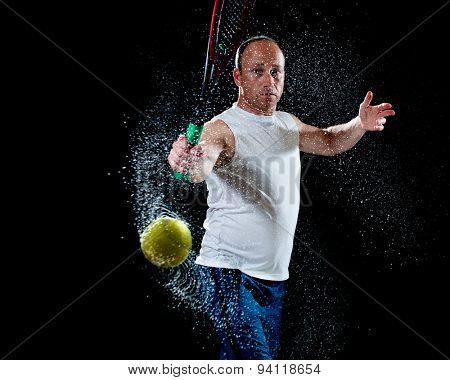 Tennis action shot. Backhand. Studio shot over black.