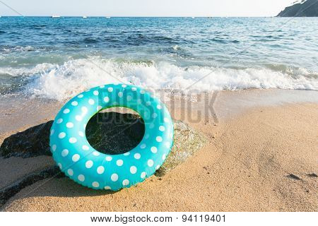 Landscape Spanish Costa Brava beach with inflatable toys